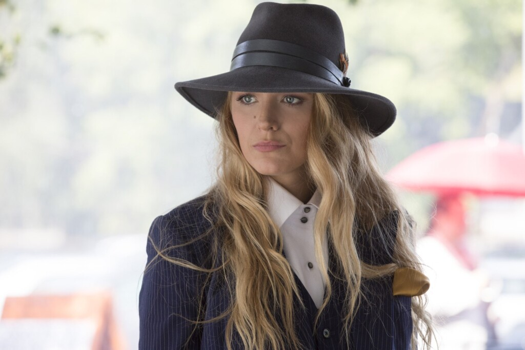 Blake Lively in a dark hat and suit