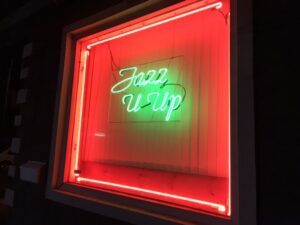 "neon sign saying ""Jazz it up"""