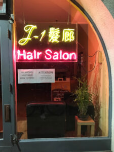 neon sign for a hair salon